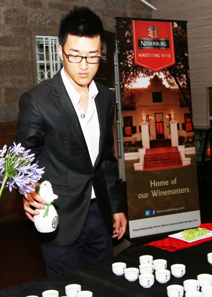 Mr. Geunhak Shin from Tokyo Japanese Restaurant pours a special welcome drink for the guests