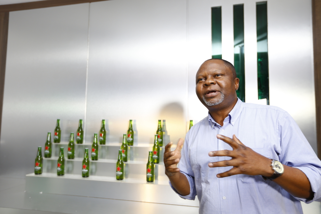 Mr. Uche Unigwe, GM Heineken East Africa unveils the Heineken Cities edition bottles during the launch of the Global Cities of the World Campaign